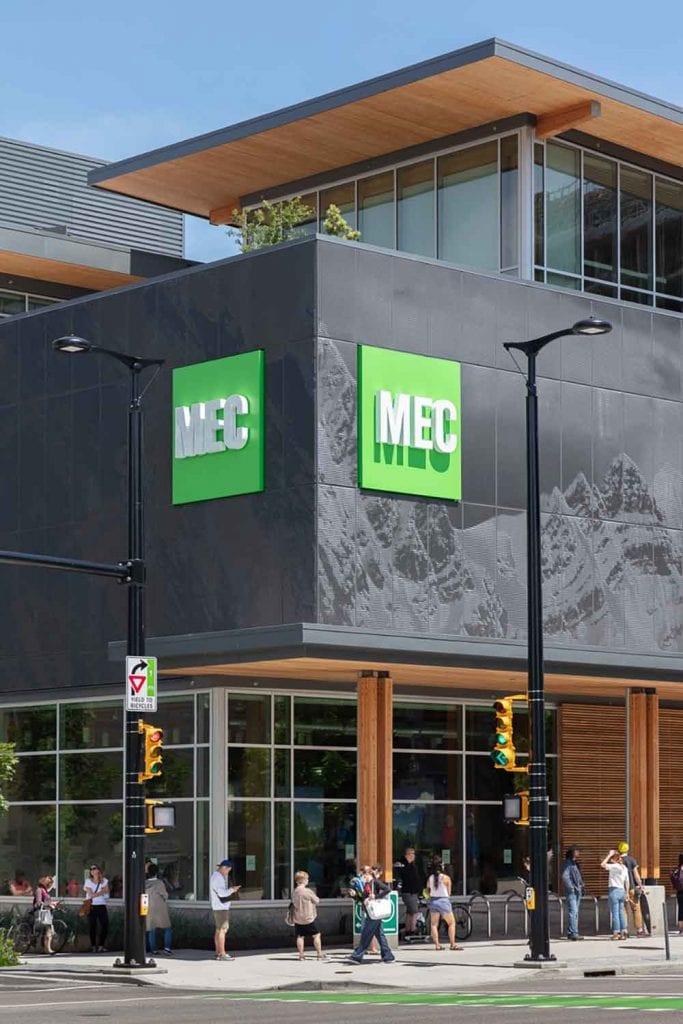 A line forms to enter Mountain Equipment Co-Op's (MEC) flagship store in Vancouver.  Landscape design by Gauthier & Associates Landscape Architecture.