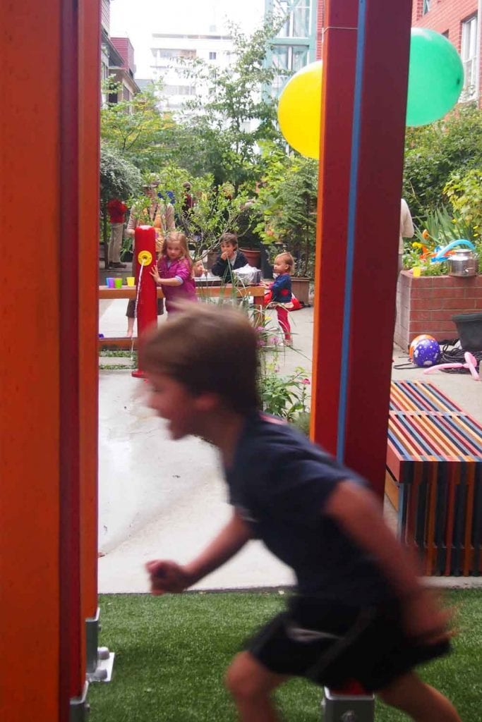 Children explore the playground by Gauthier and Associates Landscape Architecture.